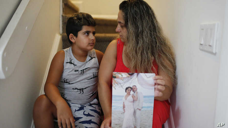 In this Aug. 6, 2019, photo, Barbara Rodriguez and her son, Nolan Aragon, 9, pose for a photograph in Hialeah, Fla. Rodriguez…