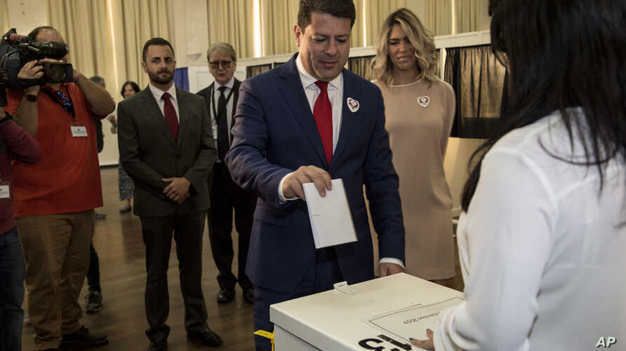 Chief Minister of Gibraltar Fabian Picardo places his vote during general elections in Gibraltar, Thursday Oct. 17, 2019. An…