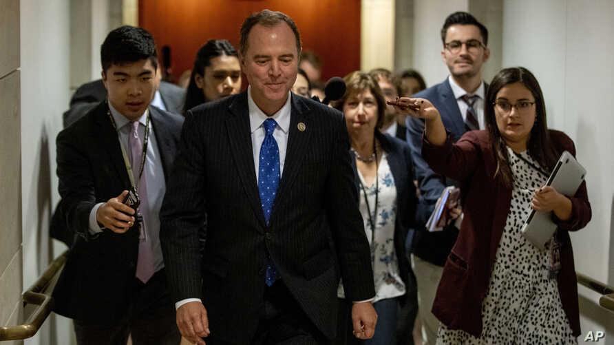House Intelligence Committee Chairman Rep. Adam Schiff of Calif., leaves a secure area where Deputy Assistant Secretary of…