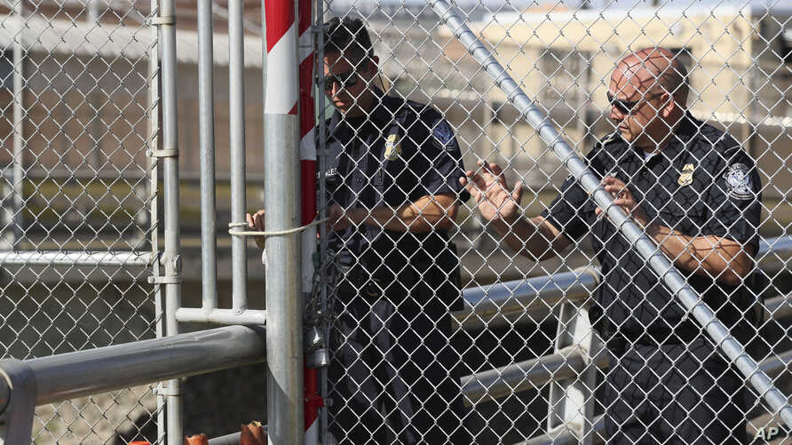 U.S. Customs and Border Protection officers reopen the border gate of the Gateway International Bridge that connects downtown…