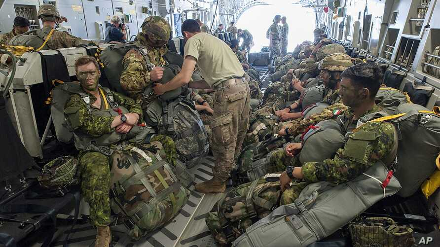 Paratroopers prepare for deployment onboard a US aircraft during the Swift Response 2017 international military exercise.