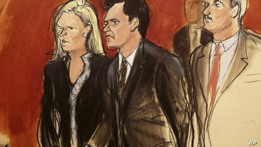FILE - In this Wednesday, May 16, 2018 file courtroom sketch, Mehmet Hakan Atilla, second left, listens to the judge during his…
