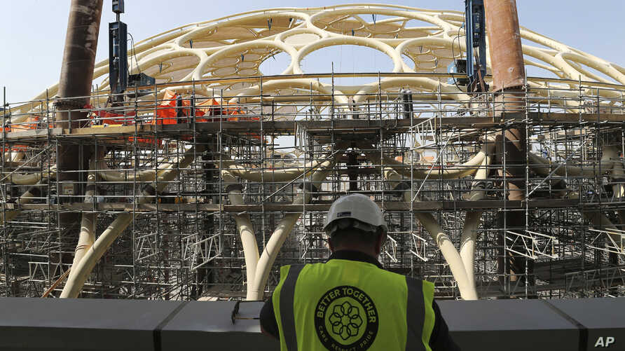 In this Oct. 8, 2019 photo, an employee of the Dubai Expo 2020 visits the Al Wasl Dome at the under construction site of the…