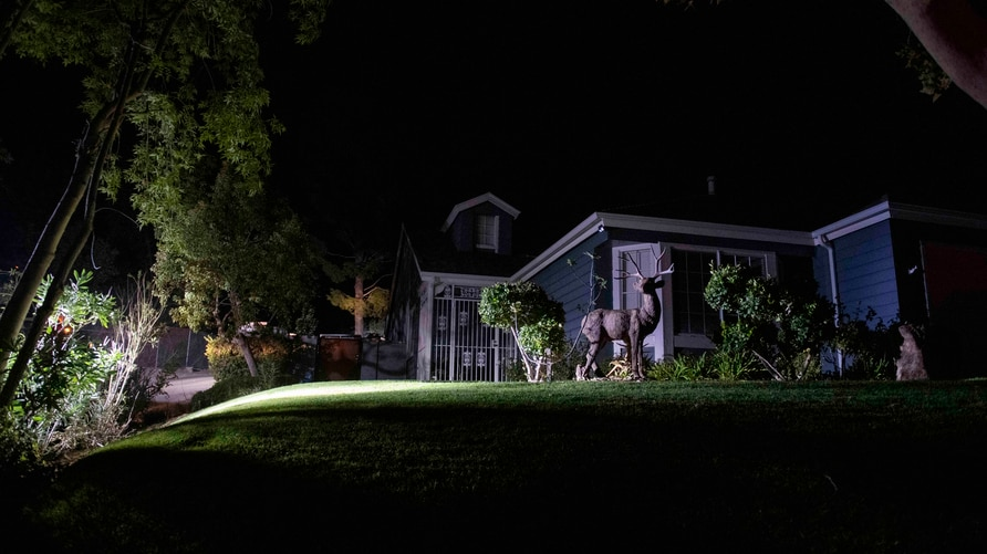A home sits without power during the Tick Fire Thursday, Oct. 24, 2019, in Santa Clarita, Calif. Fast-growing fires throughout…