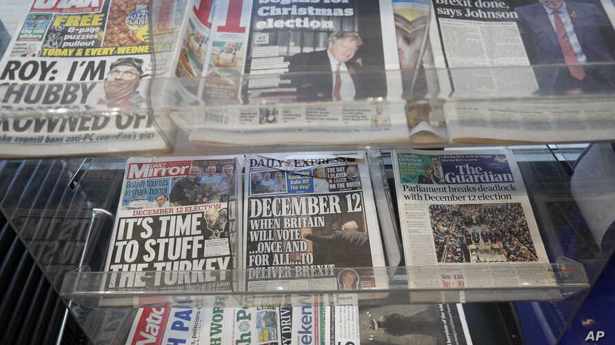 Newspaper front pages referring to the upcoming general election are displayed at a newsagent in London, Wednesday, Oct. 30,…