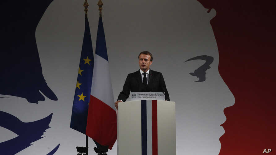French President Emmanuel Macron delivers his speech during a ceremony for the four victims of last week's knife attack in the…