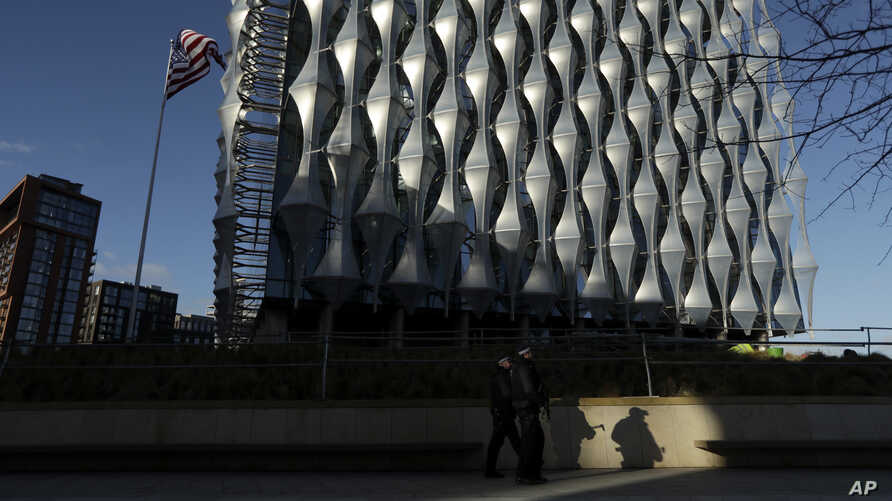 Armed British police officers patrol around the new United States Embassy building in London, Tuesday, Jan. 16, 2018. The new U…