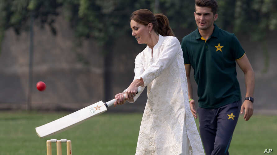 Britain's Kate, Duchess of Cambridge plays cricket as Pakistani bowler Shaheen Afridi looks on, during her visit at the…