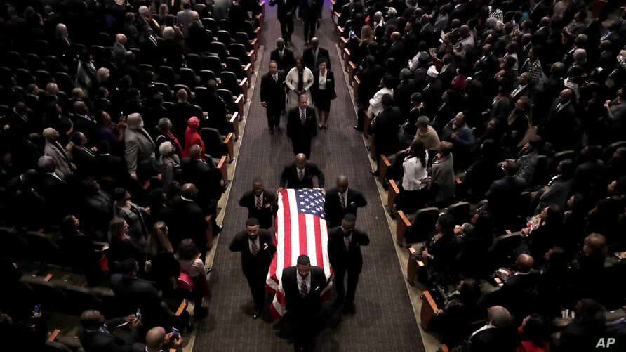 Pallbearers carry the casket of the late U.S. Rep. Elijah Cummings during funeral services at New Psalmist Baptist Church,…