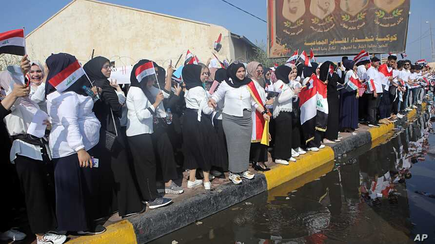 Students take part in an anti-government demonstration in Basra, Iraq,  Oct. 28, 2019