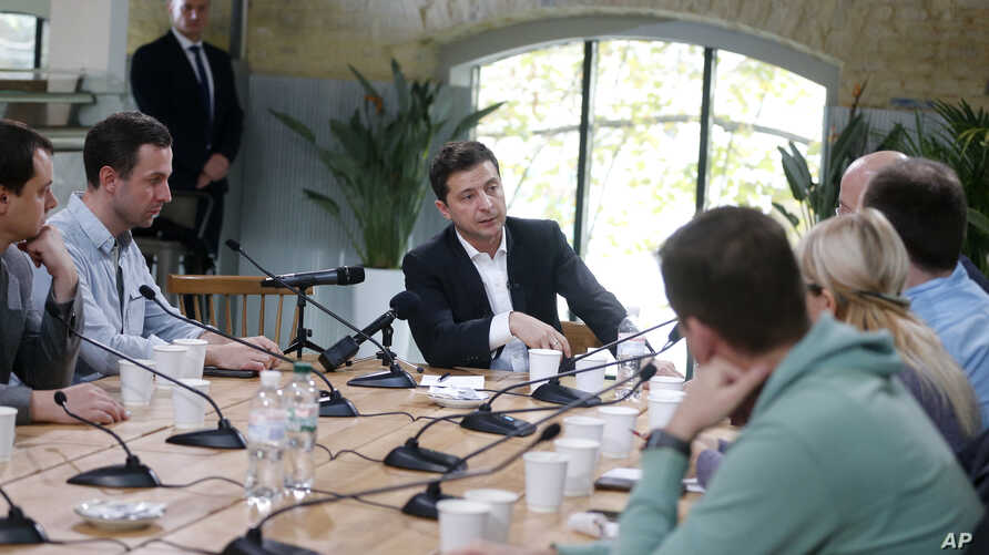 Ukrainian President Volodymyr Zelenskiy speaks during his long time talks with journalists in Kyiv, Ukraine, Oct. 10, 2019.