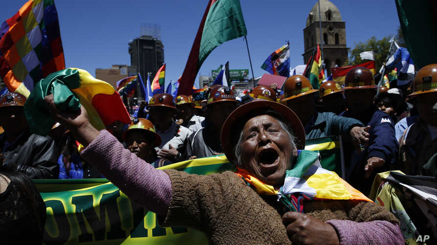 A female supporter of Bolivian President Evo Morales shows her support during a march in La Paz, Bolivia, Wednesday, Oct. 23,…