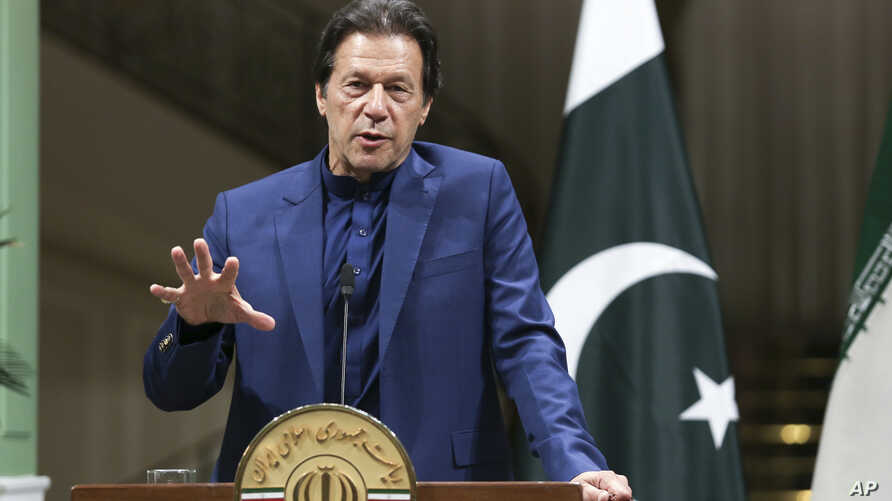In this photo released by the official website of the office of the Iranian Presidency, Pakistani Prime Minister Imran Khan…