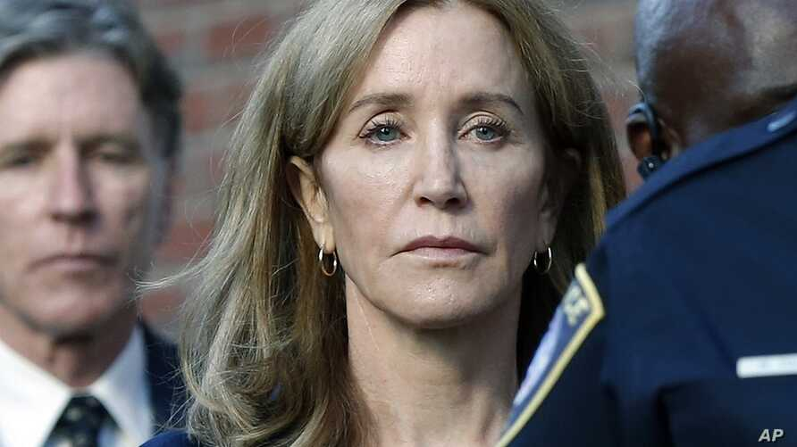 Felicity Huffman leaves federal court with her brother Moore Huffman Jr. following, after she was sentenced in a nationwide…