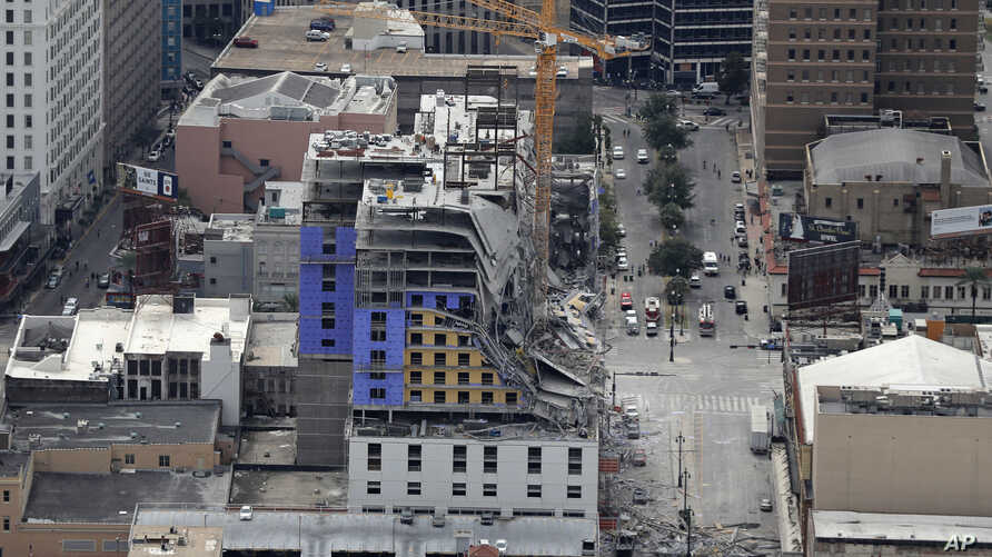 This aerial photo shows the Hard Rock Hotel, which was under construction, after a fatal partial collapse in New Orleans,…