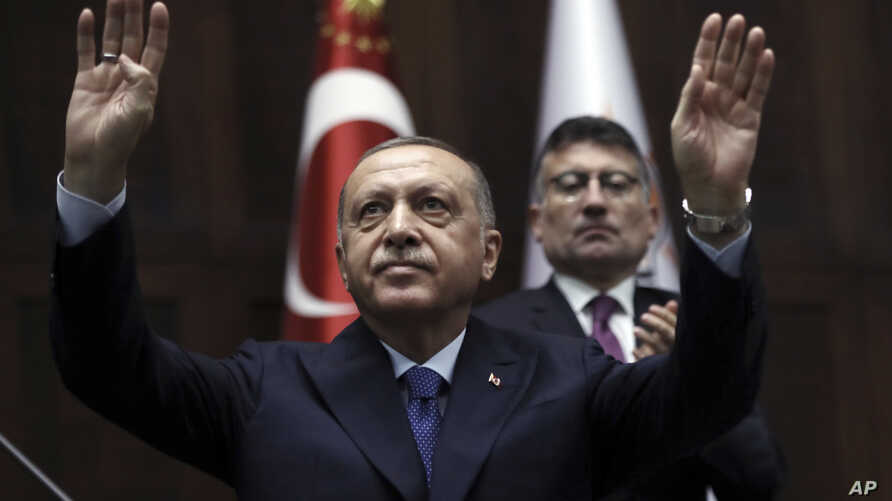 Turkish President Recep Tayyip Erdogan gestures as he addresses his ruling party legislators at the Parliament, in Ankara,…