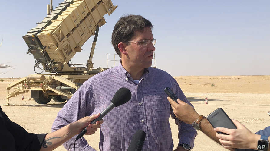 Defense Secretary Mark Esper talks to reporters at Prince Sultan Air Base in Saudi Arabia, Tuesday, Oct. 22, 2019, where he saw…