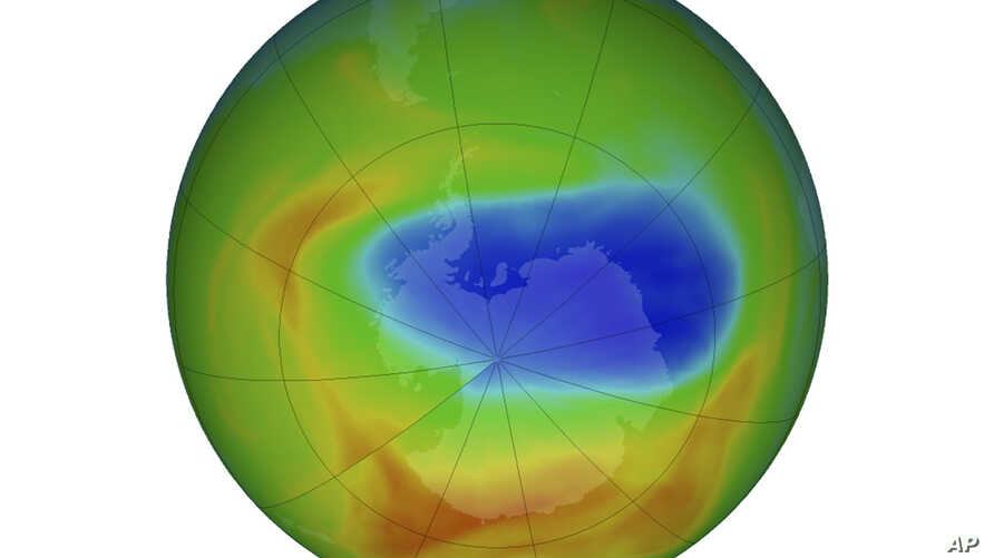 This image made available by NASA shows a map of a hole in the ozone layer over Antarctica on Sunday, Oct. 20, 2019. The purple…