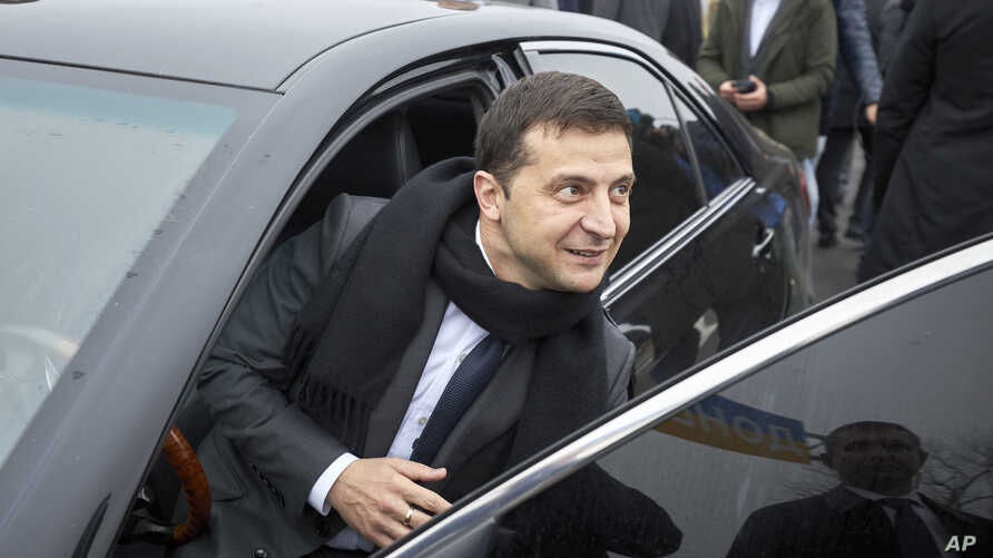 """Ukrainian President Volodymyr Zelenskiy leaves the car to attend a business forum """"RE:THINK. Invest In Ukraine"""" in Mariupol,…"""