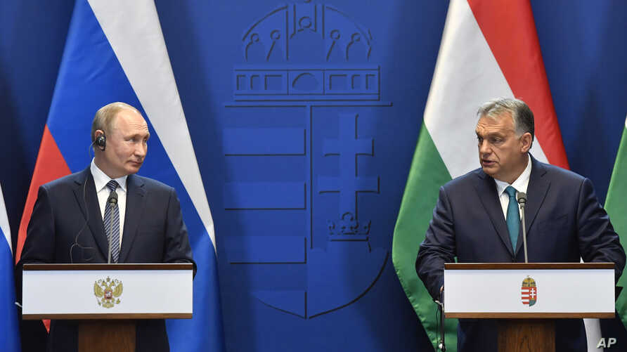 Hungarian Prime Minister Viktor Orban, right, and Russian President Vladimir Putin hold a joint press conference following…