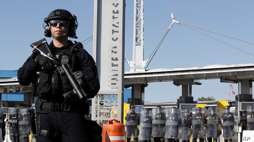 During a training drill, Customs and Border Protection officials block the entrance to the San Ysidro port of entry Thursday,…