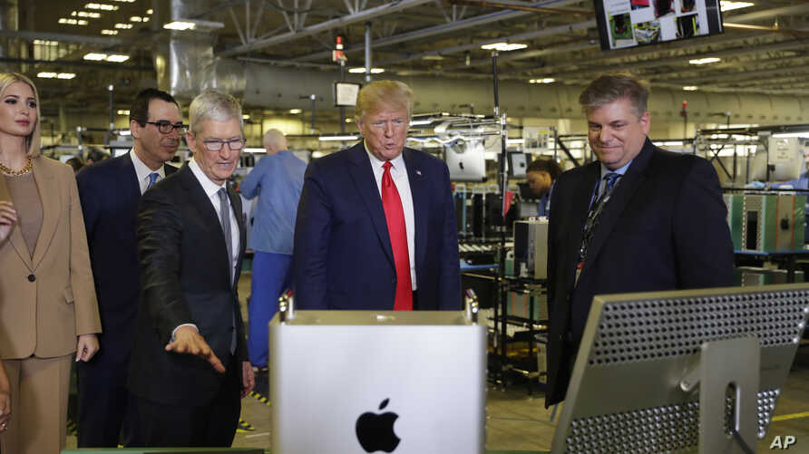 President Donald Trump tours an Apple manufacturing plant, Wednesday, Nov. 20, 2019, in Austin with Apple CEO Tim Cook, third…