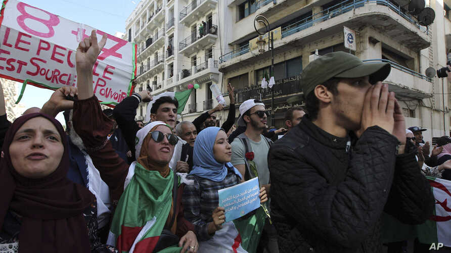 Algerian students take to the streets to protest against the government, in the capital Algiers, Algeria, Tuesday, Oct. 29,…