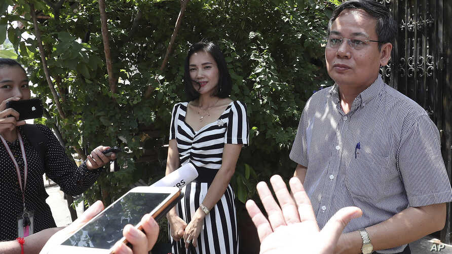Pheng Heng, right, lawyer to former Cambodia National Rescue Party's President Kem Sokha, speaks to media in front of Kem Sokha…