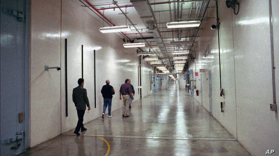 FILE - In this 1997 file photo a group of people walk down a hallway which winds through the Device Assembly Facility which…