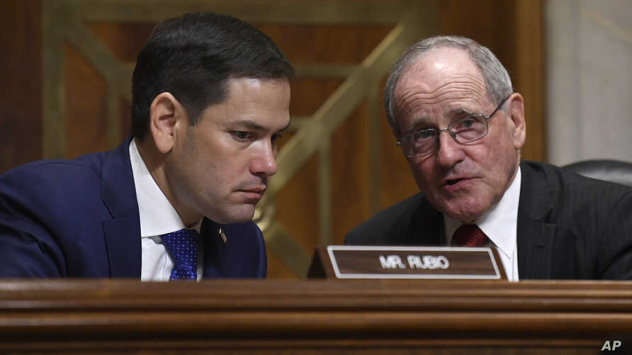Senate Foreign Relations Committee Chairman Sen. James Risch, R-Idaho, right, talks with Sen. Marco Rubio, R-Fla., left, during…