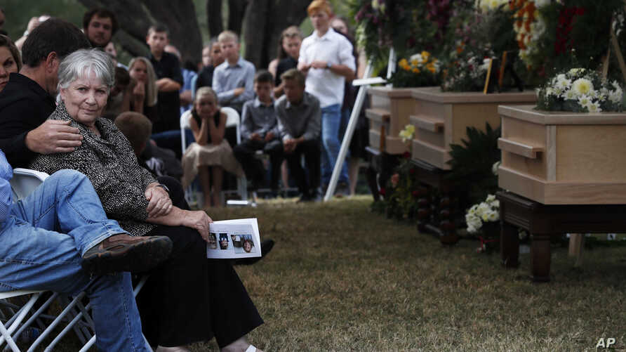 People attend the funeral of Dawna Ray Langford, 43, and her sons Trevor, 11, and Rogan, 2, who were killed by drug cartel…