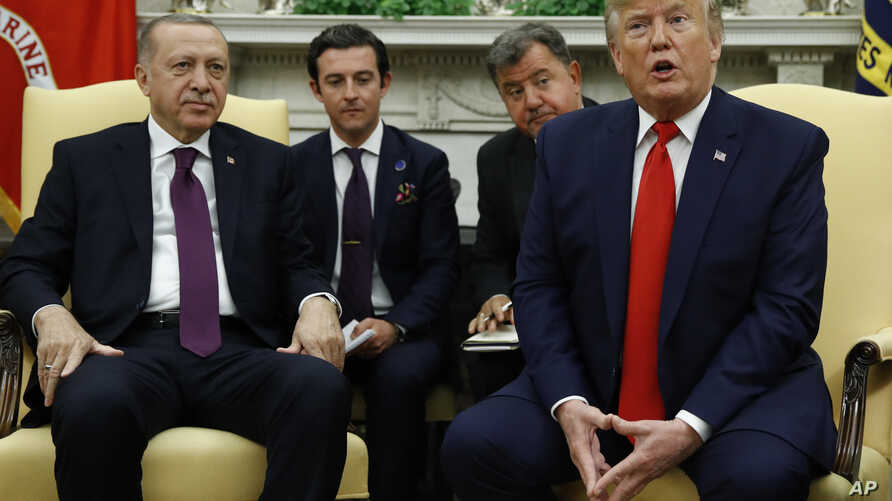 President Donald Trump and Turkish President Recep Tayyip Erdogan meet in the Oval Office with Republican senators at the White…