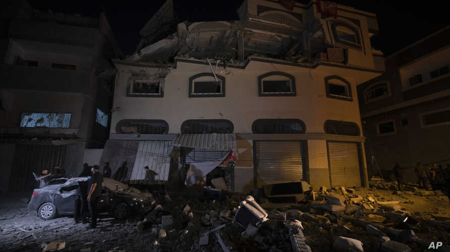 Palestinians check the damage of a house targeted by Israeli missile strikes in Gaza City, Tuesday, Nov. 12, 2019. The Israeli…