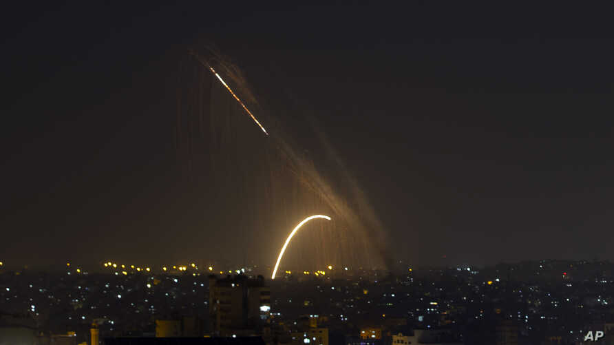 Rockets are launched from the Gaza Strip towards Israel, Wednesday, Nov. 13, 2019.  Israeli aircraft have struck Islamic Jihad…