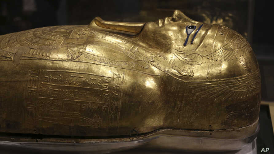 The golden coffin that once held the mummy of Nedjemankh, a priest in the Ptolemaic Period some 2,000 years ago, is displayed…