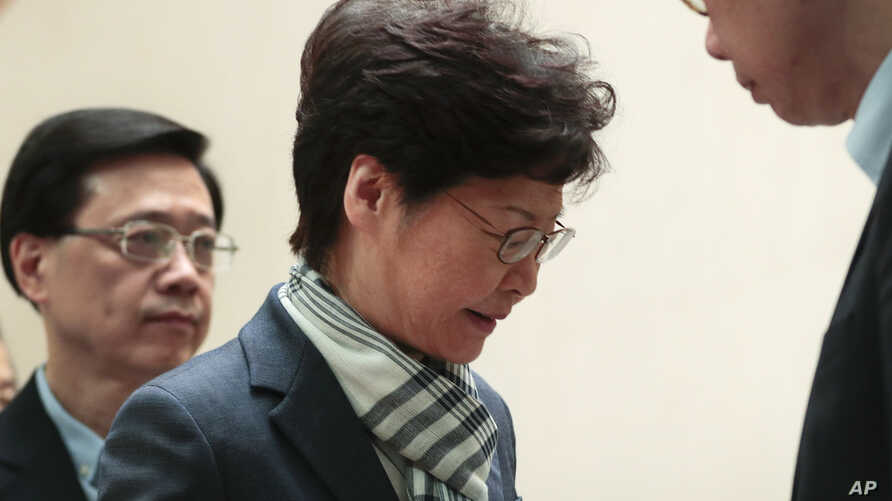 Hong Kong Chief Executive Carrie Lam leaves after a press conference in Hong Kong, Monday, Nov. 11, 2019. A protester was shot…