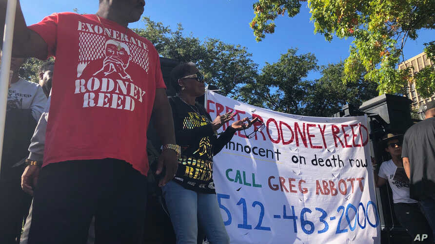 Edward Moore and Sandra Reed, mother of death row inmate Rodney Reed, rally outside the Texas governor's mansion in Austin,…