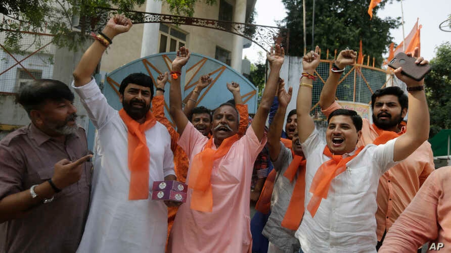 Supporters of Vishwa Hindu Parishad (VHP) or World Hindu council celebrate the Supreme Court's verdict, outside the VHP office…