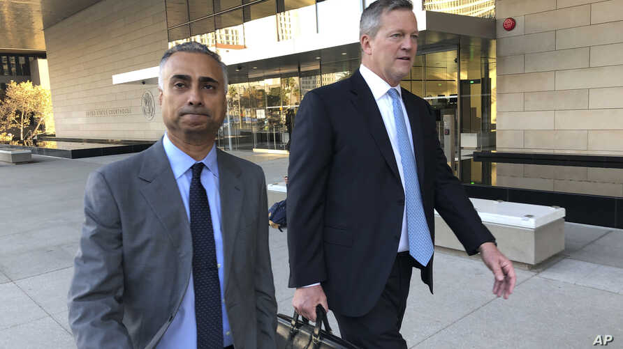 Imaad Zuberi, left, leaves the federal courthouse with his attorney Thomas O'Brien, right, in Los Angeles, on Friday, Nov. 22,…