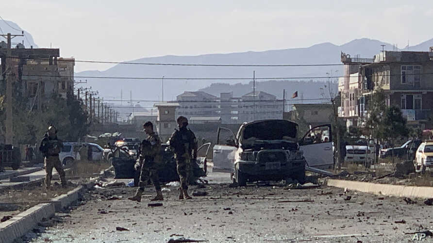 Afghan security personnel gather at the site of an explosion in Kabul, Afghanistan, Wednesday, Nov. 13, 2019. An explosion has…