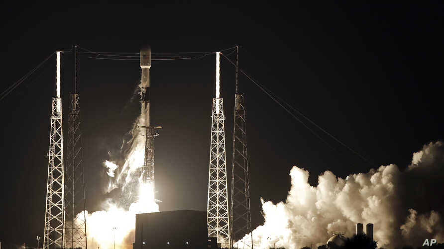 FILE - In this May 23, 2019, file photo, a Falcon 9 SpaceX rocket, with a payload of 60 satellites for SpaceX's Starlink…