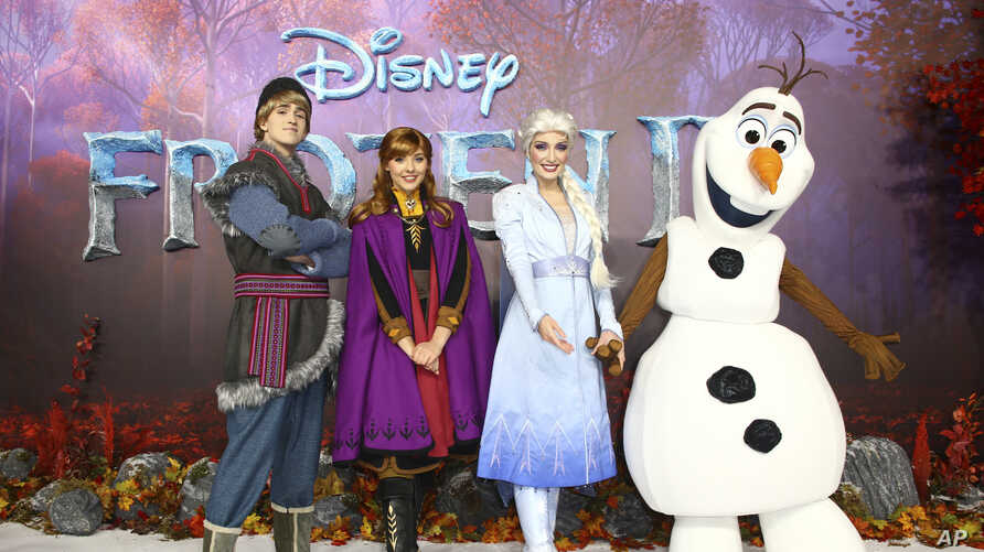 Character actors Kristoff, Anna, Elsa and Olaf pose for photographers upon arrival at the European premiere of 'Frozen 2', in…