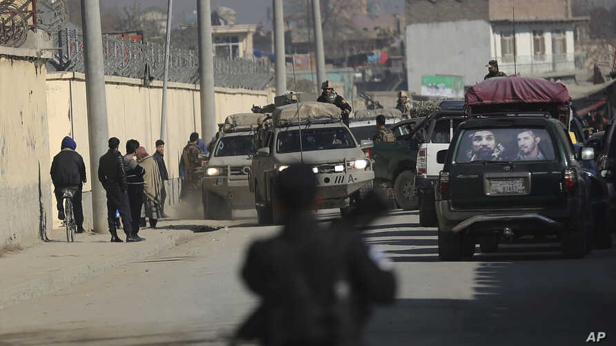 Afghan security forces' vehicles are seen at the site of a shootout in Kabul, Afghanistan, Monday, Dec. 2, 2019. An Afghan…