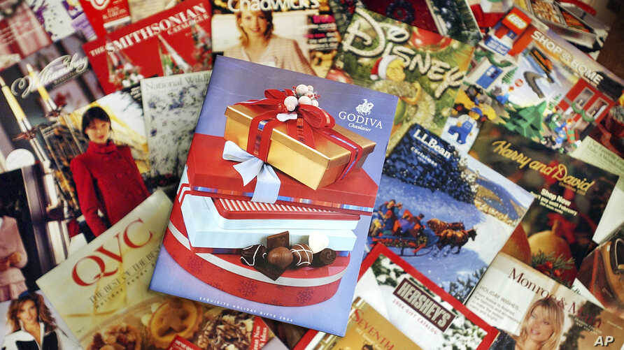 FILE - This Wednesday, Nov. 24, 2004 file photo shows a selection of holiday season catalogs in Portland, Maine. Catalogs,…