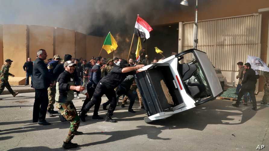 Dozens of angry Iraqi Shi'ite militia supporters damage property inside the U.S. embassy compound in Baghdad, Iraq, Dec 31, 2019.