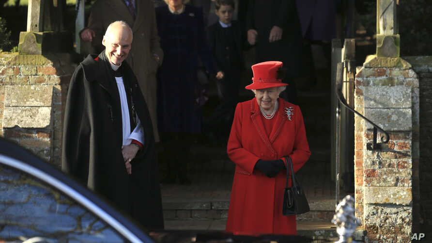 Britain's Queen Elizabeth II waits for her car after attending a Christmas day service at the St Mary Magdalene Church in…