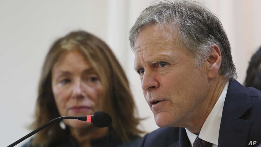 Fred Warmbier, right, speaks as his wife Cindy listens about their son Otto Warmbier who died after being released by North…