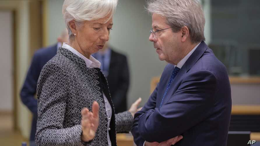 European Central Bank President Christine Lagarde, left, speaks with European Commissioner for Economy Paolo Gentiloni during a…