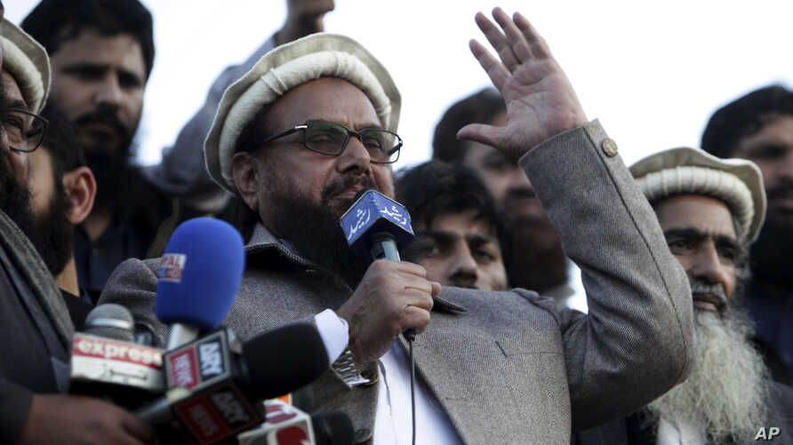 Hafiz Saeed, chief of Pakistani religious group Jamaat-ud-Dawa, addresses a rally for Kashmir Day in Lahore, Pakistan, Tuesday,…