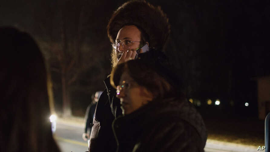 Orthodox Jewish people gather on a street in Monsey, N.Y., Sunday, Dec. 29, 2019, following a stabbing late Saturday during a…